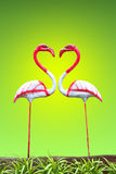 Flamingos on green background Royalty Free Stock Photo