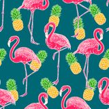 Flamingos and pineapples. Beautiful seamless pattern of pink hand-drawn flamingos and ripe pineapples stock illustration