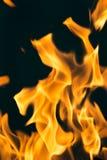 Flamma av brand som bakgrunden Arkivbild