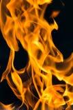 Flamma av brand som bakgrunden Fotografering för Bildbyråer