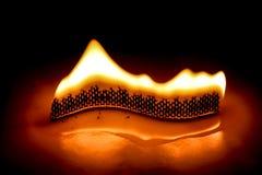 Flamma för kurvstearinljusbrand Arkivbild