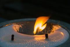 Flamma på den allvarliga stearinljuset Royaltyfria Foton