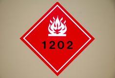 Flammable Hazard. Red flammable liquid hazard diamond sign stock photos