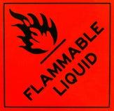 Flammable liquid warning sign. An orange flammable liquid warning sign with black writing Stock Image
