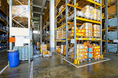 Flammable material warehouse. Warehouse with flammable liquids in cans and barrels Stock Photo
