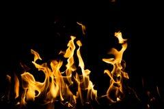 Flammabrand på svart bakgrund Fotografering för Bildbyråer