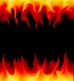 Flammar på svart bakgrund royaltyfri foto