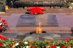Flamme éternelle de monument Sur la place des combattants tombés Photos libres de droits