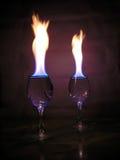 Flamme über Gläsern. Stockfotos