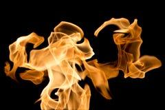 Flamme brûlante d'isolement sur le noir Image libre de droits