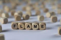 Flamme - cube avec des lettres, signe avec les cubes en bois Photographie stock libre de droits