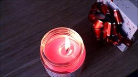 Flamme de bougie avec un paquet de cadeau clips vidéos
