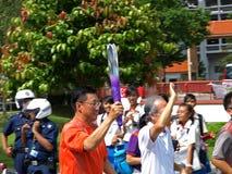 Flamme des Jeux Olympiques 2010 de la jeunesse de Singpaore ! Photographie stock libre de droits