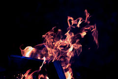 Flamme lumineuse de feu defocused toned photo stock