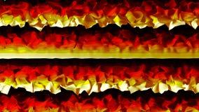 Flamme numérique colorée vibrante ou tissu sur un fond foncé banque de vidéos