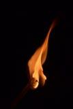 Flamme par l'allumette images stock