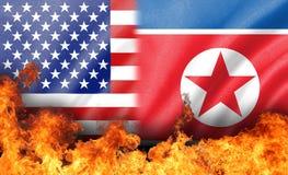 Flamme sur nous et le drapeau de la Corée du Nord Photographie stock libre de droits