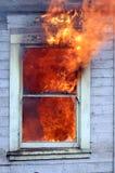 Flammen im Fenster Stockbilder