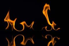 Flammes d'isolement sur le noir Photos libres de droits