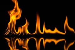 Flammes d'isolement sur le noir Photographie stock