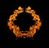 Flammes de flambage sur le fond noir photographie stock