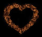 Flammes du feu de forme de coeur Photos stock