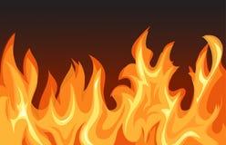 Flammes du feu sur le fond foncé Photographie stock libre de droits