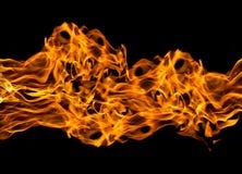 Flammes du feu sur le noir Photographie stock