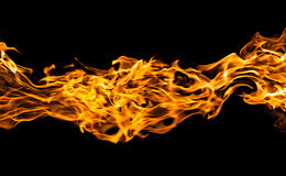 Flammes du feu sur le noir Photos stock