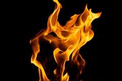 Flammes jaunes sur le noir Photographie stock libre de droits