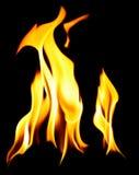 Flammes oranges au-dessus de fond foncé Photographie stock libre de droits