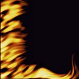 Flammes sur le noir Images libres de droits