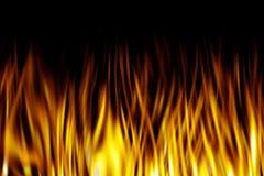 Flammes sur le noir Photo libre de droits