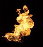 Flammes sur un fond noir Photo libre de droits