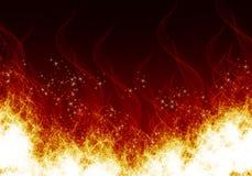 Flammes sur un fond noir Photographie stock libre de droits