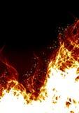 Flammes sur un fond noir Images libres de droits