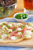 Flammkuchen. Home made flammkuchen tarte flambée with sour cream, onions and cheese bacon Stock Image