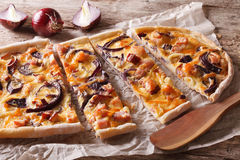 Flammkuchen with bacon and red onion on the paper. Horizontal Royalty Free Stock Photo