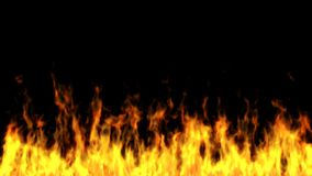 Flammor på en svart bakgrund Arkivbild