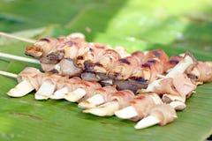 Flammulina Velutipes Mushrooms and bacon banana leaf. Stock Images
