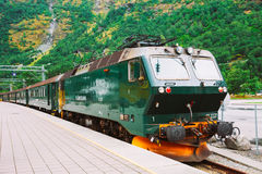 Flamsbahn In Flam, Norway. Green Train On Railway Royalty Free Stock Images