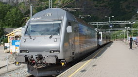 Flamsbana train arrives Flam Railway station. Flam, Norway - 2016 June: Flamsbana train arrives at Flam Railway station stock video
