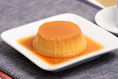 Flan. Dessert made with prime organic milk over fancy linen Royalty Free Stock Images