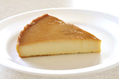 Flan. Slice of Mexican flan on white plate Stock Images