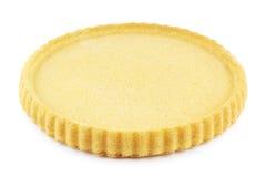 Flan case. Empty sponge cake flan case on white Royalty Free Stock Photo