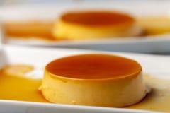 Flan. Closeup of flan dessert on plates Royalty Free Stock Photography