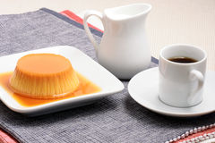 Flan and coffee. Flan dessert made with prime organic milk, berries and garnished with mint Stock Photography