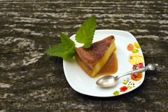 Flan creme caramel dessert. Flan - delicious creme dessert with caramel sauce.French creme caramel dessert or flan with strawberry and mint,  on the wooden Stock Photos
