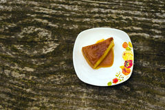 Flan creme caramel dessert. Flan - delicious creme dessert with caramel sauce.French creme caramel dessert or flan with strawberry and mint,  on the wooden Stock Photo