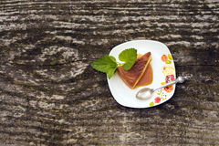 Flan creme caramel dessert. Flan - delicious creme dessert with caramel sauce.French creme caramel dessert or flan with strawberry and mint,  on the wooden Royalty Free Stock Images
